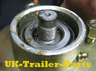 The greased hub is placed on the wheel shaft