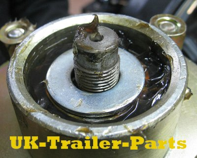 Apply grease and a large washer over the top bearing